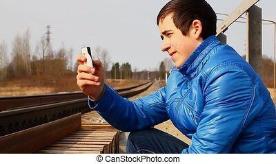 Teen with cell phone take a picture