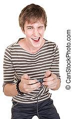 Teen With Controller - Caucasian teen holding joystick winks...