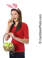 Teen with easter eggs - teen with bunny ears holding a...