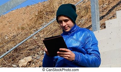 Teen with tablet PC at outdoor