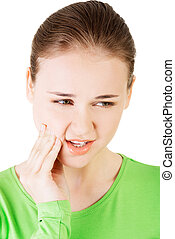 Teen woman having a terrible tooth ache.