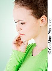Teen woman having a terrible tooth ache.