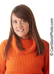 Teen woman in orange sweater