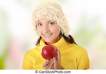 Teen woman with red apple