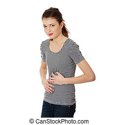Teen woman with stomach issues,isolated on white