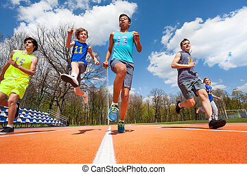 Teenage athletes having fun on the racetrack