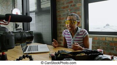 Teenage blogger recording video at desk 4k - Teenage blogger...