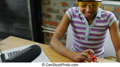 Teenage blogger soldering a circuit board 4k