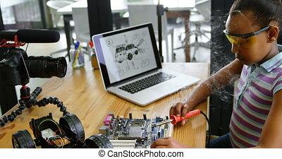 Teenage blogger soldering a circuit board 4k - Teenage ...