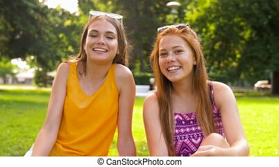 teenage bloggers recording video blog in park - blogging and...