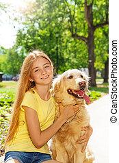 Teenage blonde girl with retriever dog otside - Beautiful...