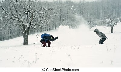 Teenage boy and girl in winter nature. Two teenagers having...