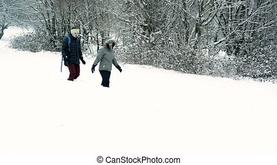 Teenage boy and girl in winter nature.