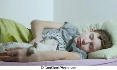 Teenage boy asleep in bed. man tired shaggy teenage boy...