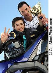 Teenage boy celebrating his win