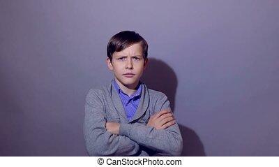 Teenage boy doing a superhero hand with binoculars watching the power of confidence