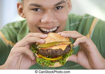 Teenage Boy Eating Burger
