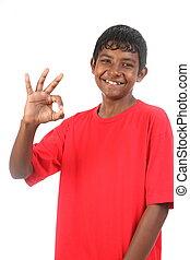 Teenage boy gives OK signal - Teenager boy gives OK signal...
