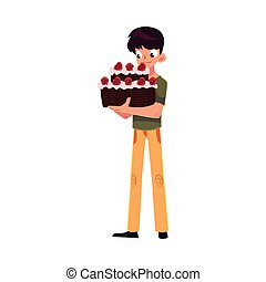 Teenage boy holding chocolate birthday cake with red roses