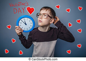 Teenage boy in glasses holding a clock Valentine's Day celebrati