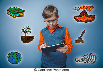 Teenage boy in glasses holding a tablet thoughtful science geolo