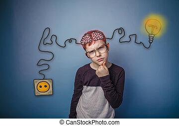 Teenage boy in glasses thinking brain booster charge...