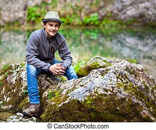 Teenage boy in mountains