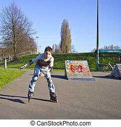 teenage boy in protection kit roller-blading