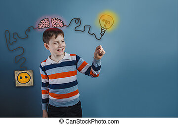 Teenage boy laughing and holding a finger subject igniter charge charging cord plug wires and sketch infographics