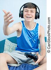 Teenage boy playing a video game