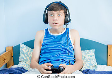 Teenage boy playing a video game