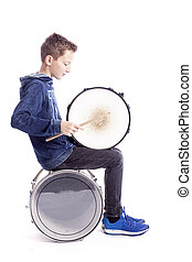teenage boy plays drum in studio
