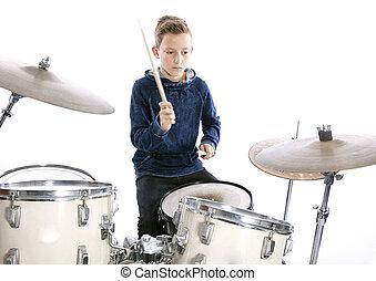 teenage boy plays drums in studio