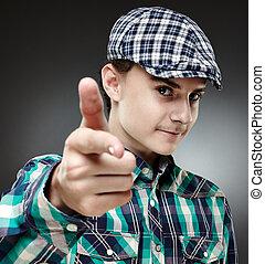 Teenage boy pointing at camera