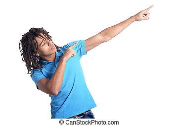 Teenage boy pointing isolated on white background
