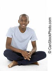 Teenage Boy Sitting In Studio