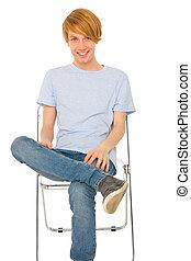 teenage boy sitting on chair