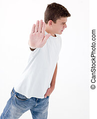Teenage boy standing with hand up