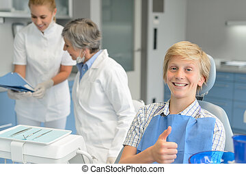Teenage boy teeth checkup dental surgery dentist