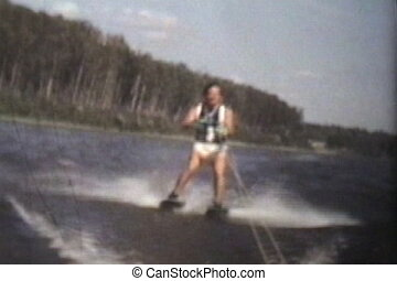 Teenage Boy Trick Waterskiing 1978 - A teenage boy shows off...