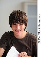 Teenage boy turning a page