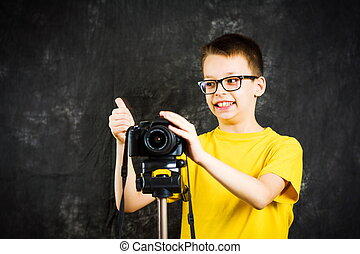 Teenage boy using big digital camera - Teenage boy learning...