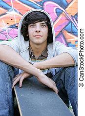 teenage boy with a skate board