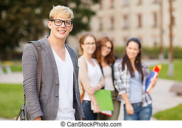 teenage boy with classmates on the back