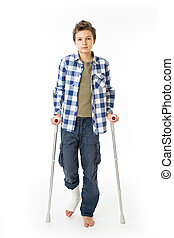 Teenage Boy with crutches and a bandage on his right leg