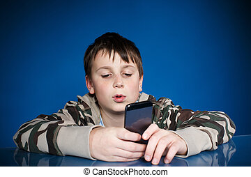 teenage boy with phone in hand