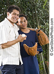 Teenage boy with proud father - African American teenage boy...