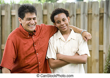 Teenage boy with proud father