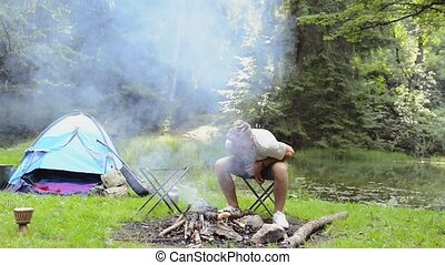 Teenage boys camping at the lake in forest. - Teenage boys...