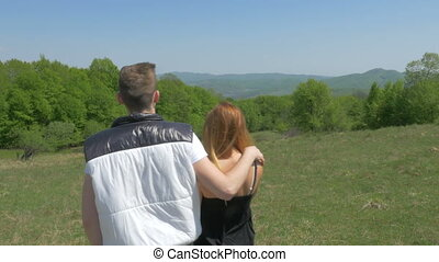 Teenage couple enjoying nature
